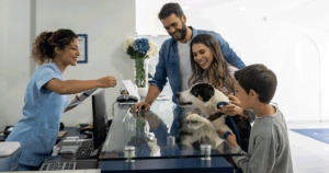 Veterinary clinic front desk with family