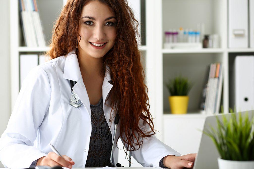 Veterinarian at computer